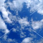 many clouds over the deep blue sky